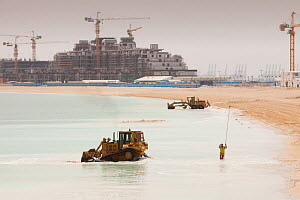 Workers creating a new beach resort in Dubai. March 2009 - Visuals Unlimited