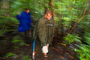 Researchers Guido and Katja Westhoff walk through tribal Uningan Nature Reserve bushland. The reserve covers over 2,800 hectares and includes habitats such as open woodland, palm forests and mangroves... - Jurgen Freund