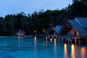 Bungalows of Misool Eco Resort as night falls. Misool, Raja Ampat, West Papua, Indonesia, January 2010  -  Jurgen Freund