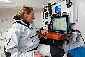 "Skipper Jeanne Gregoire at navigation station on board monohull ""Banque Populaire"" in training for Transat Benodet-Martinique at the start of Figaro Season. Port la Foret, Brittany, France, April 2011...  -  Benoit Stichelbaut"