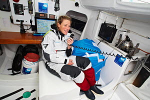 "Skipper Jeanne Gregoire using radio on board monohull ""Banque Populaire"" in training for Transat Benodet-Martinique at the start of Figaro Season. Port la Foret, Brittany, France, April 2011. All non-...  -  Benoit Stichelbaut"