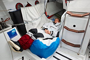 "Skipper Jeanne Gregoire sleeping on board monohull ""Banque Populaire"" in training for Transat Benodet-Martinique at the start of Figaro Season. Port la Foret, Brittany, France, April 2011. All non-edi...  -  Benoit Stichelbaut"