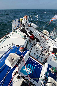 "Skipper Jeanne Gregoire helming on board monohull ""Banque Populaire"" in training for Transat Benodet-Martinique at the start of Figaro Season. Port la Foret, Brittany, France, April 2011. All non-edit...  -  Benoit Stichelbaut"