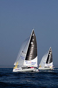 """Bretagne Credit Mutuel Performance"" and ""Bretagne Credit Mutuel Espoir"" racing at the start of the Transat Benodet-Martinique. Brittany, France, April 2011.  -  Benoit Stichelbaut"