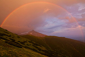 Rainbow over the summit of Mt. Krivan (national symbol of Slovakia) at sunset. Western Tatras, Slovakia, June.  -  Bruno D'Amicis