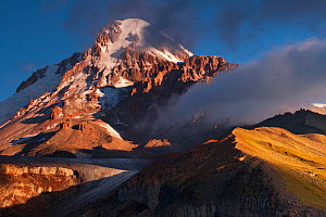 Southern slope of Mount Kazbek/Mkinvartsveri (5,033m/16,512ft) and Gergeti glacier in the Khokh range at sunrise. Greater Caucasus, Georgia, September 2010.  -  Bruno D'Amicis
