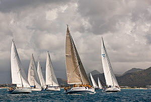 Fleet racing beneath stormy skies during the Heineken Regatta, St Martin, Caribbean, March 2011. - Onne van der Wal