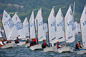 Youth fleet racing during the Optimist North Americans, Newport, Rhode Island, USA, August 2010. - Onne van der Wal