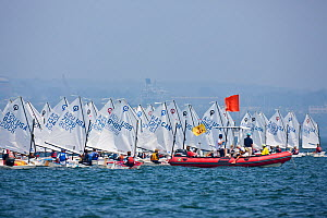 Fleet and officials during the Optimist North Americans, Newport, Rhode Island, USA, August 2010. - Onne van der Wal