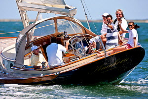 """Crew waving from the cockpit of """"Anabera"""" during a Friendship Yachts rendezvous. Nantucket, Maine, USA, August 2010. All non-editorial uses must be cleared individually.  -  Onne van der Wal"""