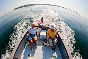 Elderly ladies cruising off Northeast Harbor in a classic wooden power boat, Maine, USA, September 2010. All non-editorial uses must be cleared individually.  -  Onne van der Wal