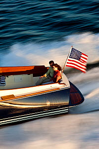 Couple on board Hinckley T38 speedboat travelling at speed. Rhode Island, USA, August 2008. All non-editorial uses must be cleared individually.  -  Onne van der Wal