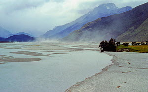 Wind blowing dust from a river bed to form loess soil elsewhere. North of Lake Wakatipu, South Island, New Zealand, August 2007 - Visuals Unlimited
