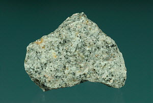 Granite is a crystalline igneous rock consisting of potassium feldspar and quartz with hornblende and mica as common accessory minerals. - Visuals Unlimited
