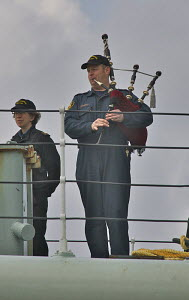 "Piper onboard Canadian Warship ""HMCS Athabaskan"" as she arrives in Liverpool for a visit. River Mersey, England, April 2011. For editorial use only. - Graham Brazendale"