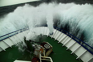Huge wave hitting the bow of fishing vessel on the North Sea, Europe, April 2011. Property released. - Philip Stephen