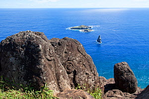 """Rock petroglyphs at Orongo with the """"Bird Man"""" islets in the background. Orongo, Easter Island, October 2009.  -  Brent Stephenson"""