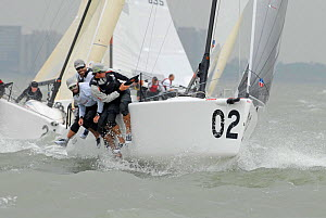 "Crew hiking-out on board ""Brick House 812"" during the Melges 24 World Championships. Corpus Christi, Texas, USA, May 2011. - Rick Tomlinson"