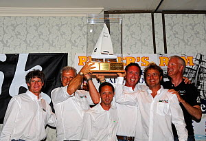 """UkaUka Racing"" team collecting trophy after winning the Melges 24 World Championships. Corpus Christi, Texas, USA, May 2011.  -  Rick Tomlinson"