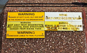 Hazard warning sign on promenade wall at New Brighton, Merseyside, England, May 2011. - Norma Brazendale