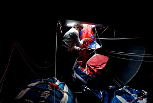 """""""All4One"""" team stowing sails below deck ahead of the 2011 Audi MedCup Circuit. Spain, May 2011. All non-editorial uses must be cleared individually. - Franck Socha"""
