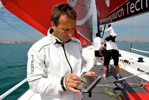 """All4One"" team member using hand held navigational device ahead of the 2011 Audi MedCup Circuit. Spain, May 2011. All non-editorial uses must be cleared individually. - Franck Socha"