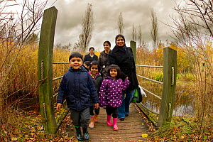 Family walking down path at Conkers, Visitor Centre, The National Forest, Derbyshire, UK, November 2010. 2020VISION Exhibition. 2020VISION Book Plate. Did you know? Since 1995 nearly a quarter of a mi... - Ben Hall / 2020VISION