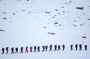 Line of mountain walkers in winter, Lochain Mountains, Cairngorms NP, Highlands, Scotland, UK, February 2010. 2020VISION Exhibition. 2020VISION Book Plate.  -  Peter Cairns / 2020VISION