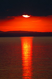 Sunset over calm sea. June 2010. - Peter Cairns / 2020VISION