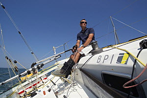 """Skipper Jeremie Beyou helming on board """"BPI"""" ahead of La Solitaire du Figaro 2011. Lorient, France, June 2011. All non-editorial uses must be cleared individually.  -  Benoit Stichelbaut"""