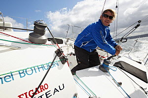 """Skipper Michel Bothuon winching on board """"Les Recycleurs Bretons"""" ahead of La Solitaire du Figaro 2011. Brest, France, May 2011. All non-editorial uses must be cleared individually. - Benoit Stichelbaut"""