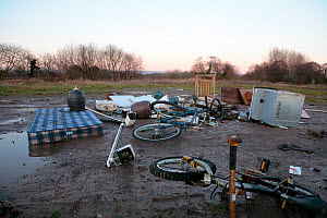 Illegally discarded rubbish and scrap metal close to the village of Westhay, Somerset, UK. January 2011. - John Waters
