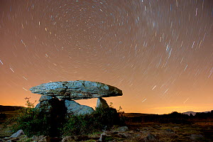 Dolmen d'Eyna at night, with a long exposure capturing star trails. Eyne, Pyrenees, France, September 2010. - Inaki Relanzon