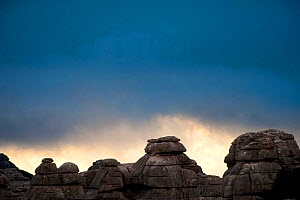Limestone formations under a heavy sky. Torcal de Antequera Nature Reserve, Malaga, Spain, November 2009.  -  Inaki Relanzon