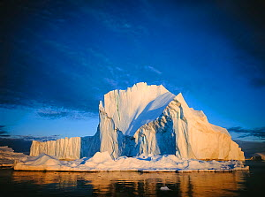 Iceberg against a blue sky. Ilulisat, West Greenland, summer.  -  Inaki Relanzon