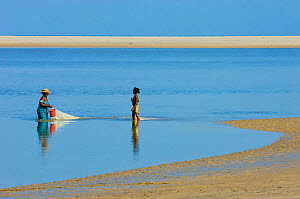 Woman and girl fishing on the beach. Morondava, Madagascar, Africa.  -  Inaki Relanzon