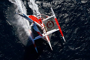 "Aerial view of MOD70 trimaran ""Veolia Environnement"", skippered by Roland Jourdain, off the coast of Concarneau. Brittany, France, June 2011. All non-editorial uses must be cleared individually.  -  Benoit Stichelbaut"