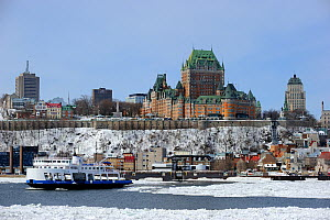 Frontenac Castle and St Lawrence river ferry boat in melting ice. Quebec, Canada, March 2011.  -  Eric Baccega
