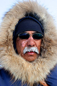 Mauris Spence, local INuit indigenous guide for polar bear expeditions. Frost on moustache. Wapusk National Park, Churchill, Manitoba, Canada, March 2011.  -  Eric Baccega