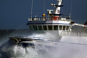 Wave hitting foredecks of fishing vessel on the North Sea, May 2011.  -  Philip Stephen
