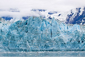 Face of the glacier with massive cracks and seracs, showing layers of ice. Hubbard Glacier, Alaska, United States, July 2010. - Brent Stephenson