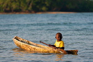 Instead of bicycles, children have dugout canoes to paddle for getting to places and to burn off energy, Marovo Lagoon, Solomon Islands, Melanesia, Pacific, July 2010. - Jurgen Freund