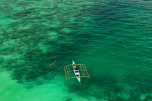 Aerial view of farmers on outrigger boat working at a seaweed farm growing agar-agar for processing into carageenan (gelatinous extracts used as binder for food or product) Philippines, May 2009. - Jurgen Freund
