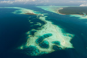 Aerial view of coral cays and white sand bars surrounding Bugsuk Island, Farm 1 of Jewelmer pearl farm. This private island has been highly protected since the 1970's and is in pristine environmental... - Jurgen Freund