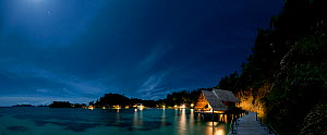 Moonlit landscape of the bungalows of Misool Eco Resort, Raja Ampat, Indonesia, January 2010.  -  Jurgen Freund