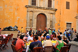 Street musicians playing for tourists in front of Santo Domingo Church, in Cartagena de Indias city, a UNESCO World Heritage City. Magdalena Department, Colombia, February 2011. Statue by Botero in ba... - Luiz Claudio Marigo
