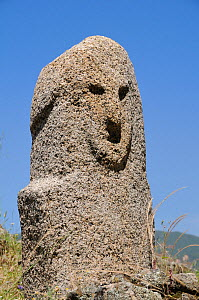 Close up of Bronze age (c 3,500 year old) granite statue menhir standing stone at Filitosa with carved face. Corsica, France, June 2010. - Nick Upton