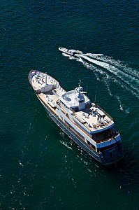 """Aerial image of superyacht """"Axantha II"""" with tender alongside, Brittany, France, June 2011. All non-editorial uses must be cleared individually.  -  Benoit Stichelbaut"""