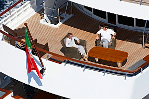 """Couple relaxing on board superyacht """"Axantha II"""", Brittany, France, June 2011. All non-editorial uses must be cleared individually.  -  Benoit Stichelbaut"""