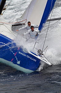"""Wet crew on the bow of monohull """"Banque Populaire"""" during training ahead of Transat Jacques Vabre 2011. Lorient, Brittany, France, July 2011. All non-editorial uses must be cleared individually. - Benoit Stichelbaut"""